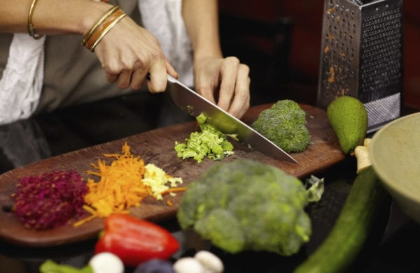 Cropped image of a woman preparing dinner at home