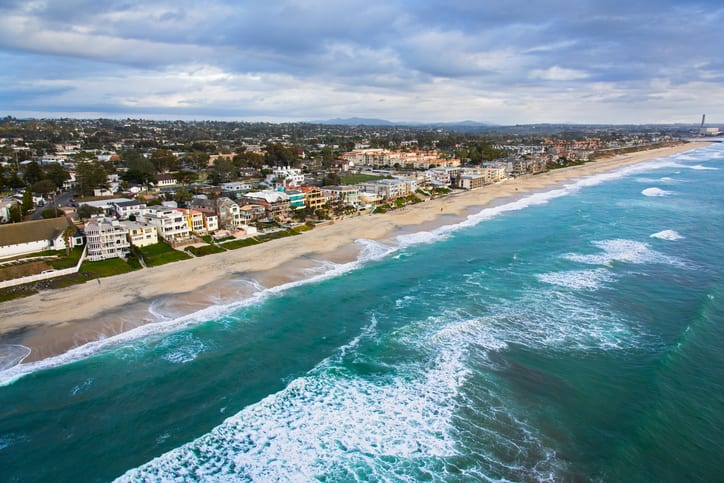 The coast and beaches of the beautiful city of Carlsbad, California located in northern San Diego County. I shot this image during a chartered photo flight in a helicopter at approximately 300 feet elevation over the ocean.